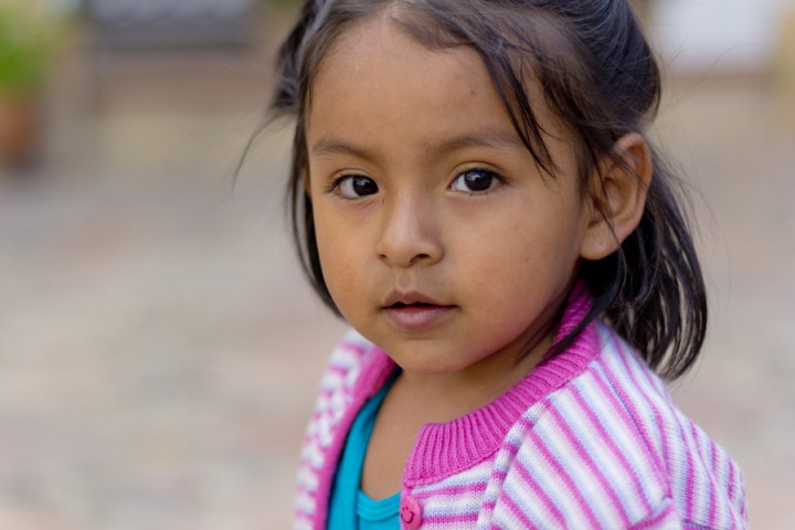 Sucre, Bolivia - January 17, 2012: A Young Girl Faces The Camera