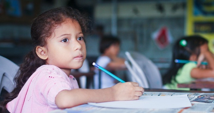GUAYAQUIL, ECUADOR - FEBRUARY 8: Unknown kid in lesson drawing i